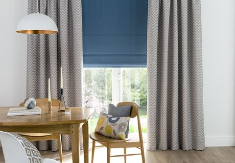 Natural Dining Room decorated with Grey Kitchen Curtains layered with a statement blue roman blind