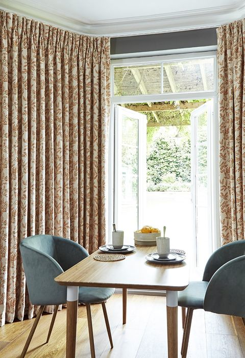 Dining Room with patio doors out to the garden dressed with Orange Pinch Pleat Curtains in Deliza Nectarine Fabric