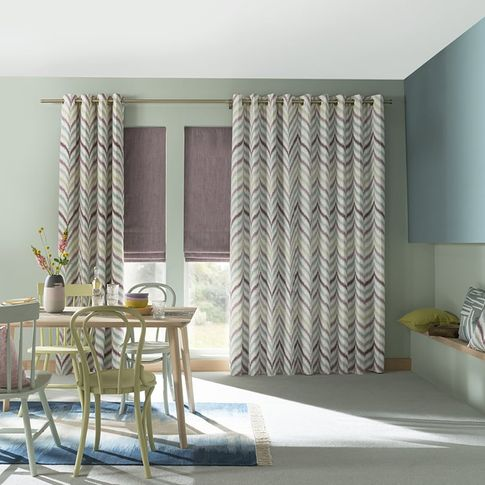 Colourful Dining Room with large windows dressed with Eyelet kitchen Curtains and soft pink roman blinds