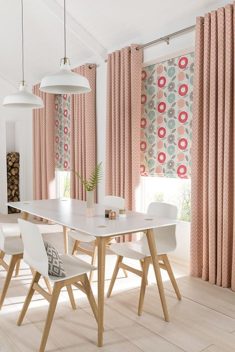 Dining room with wide patio doors dressed with Pink kitchen Curtains