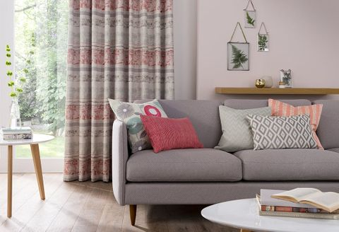 Modern lounge with a grey sofa and Red and Pink living room curtains