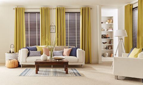 Light and cosy Living Room with plain Yellow Curtains and dark wood venetian blinds