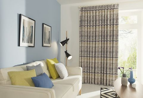 Minimalist lounge with blue and yellow living room curtains and matching decor