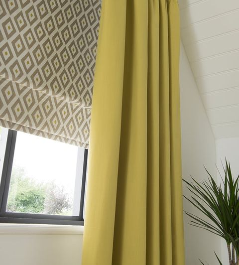 Close-up of Plain Yellow Curtains