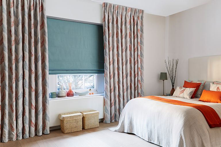 Colourful Bedroom with window dressed with Pinch Pleat Curtains in Tranquility Dawn Fabric