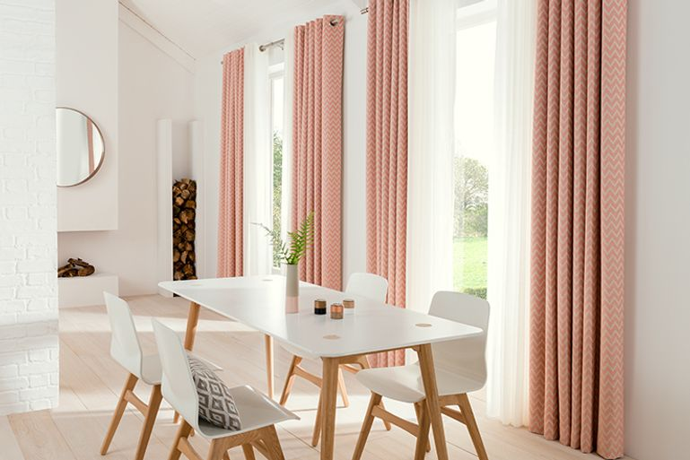Light Dining Room with floor to ceiling windows with pink thermal Curtains in Horizon Salmon fabric