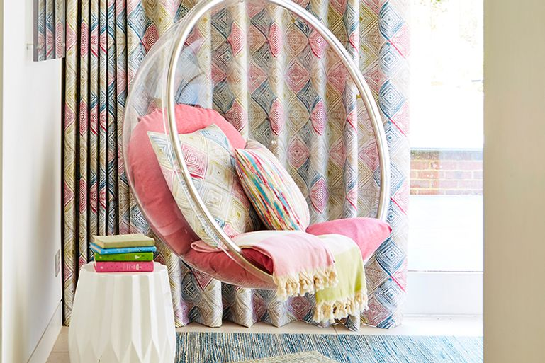 Living Room with a Swing Chair in front of Multicoloured Wave Curtains in Quadro Festival Fabric