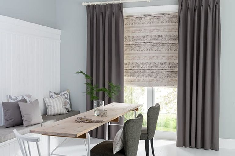 Minimalist Dining room with patio doors dressed with dark grey curtains