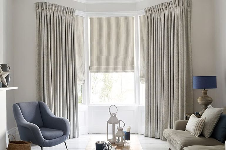 Modern minimalist living room with full length silver curtains
