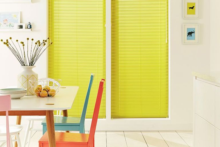 Dining room window with Marigold Venetian blinds