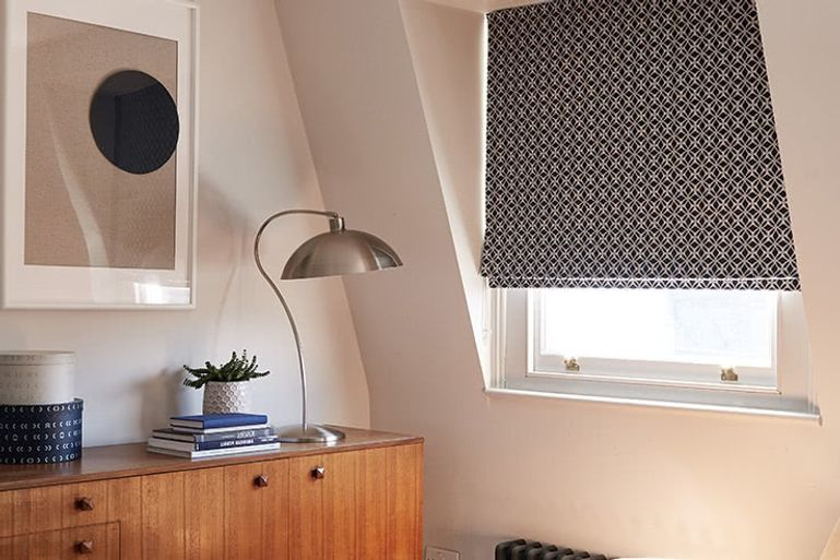 small blackout roller blind in a window