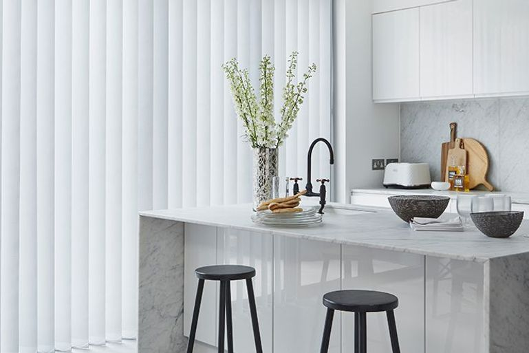 modern kitchen diner with silver vertical blinds