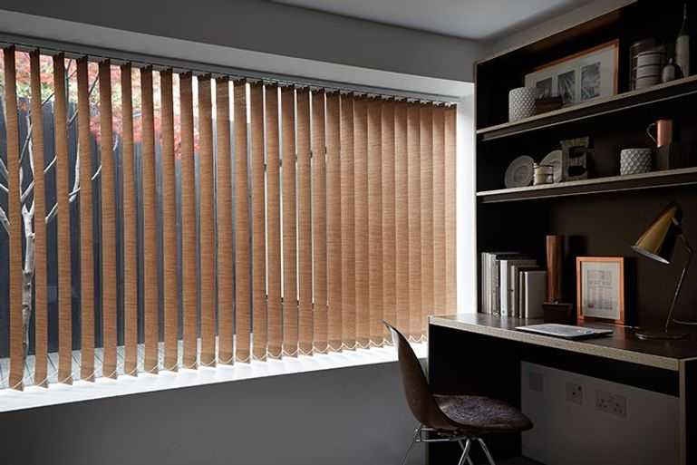 copper vertical blinds in a home office window