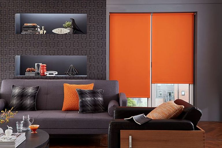 deep orange roller blinds in a living room window