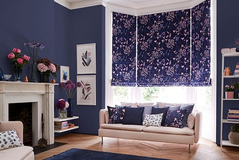 colourful purple roman blinds with pink geometric pattern in a bedroom window