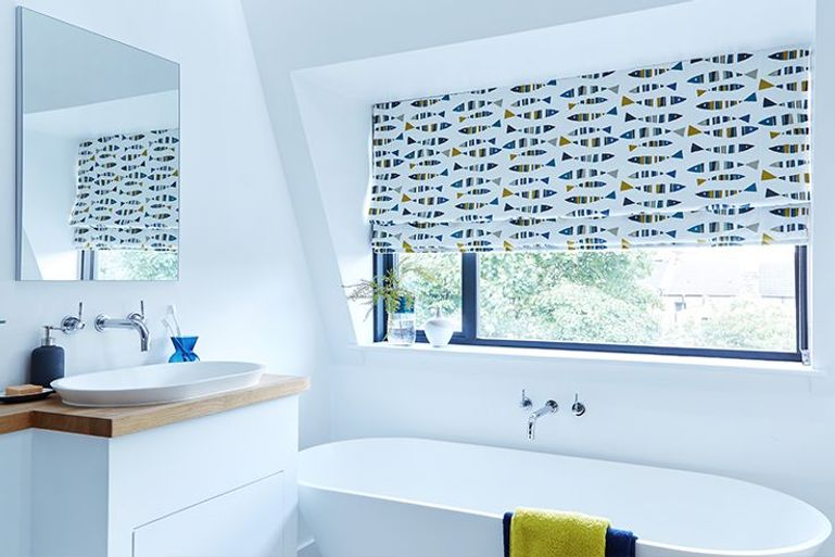 modern colourful fish pattern roman blinds in a bathroom window