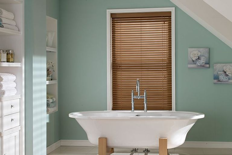 faux oak venetian blinds in a bathroom window