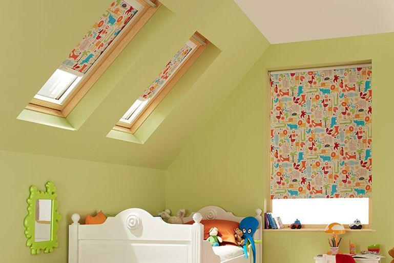 kids bedroom with blackout animal print fabric blinds in velux windows