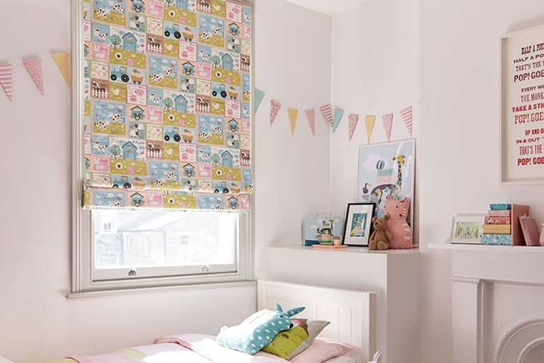 colourful farm animal pattern blinds in a kids bedroom