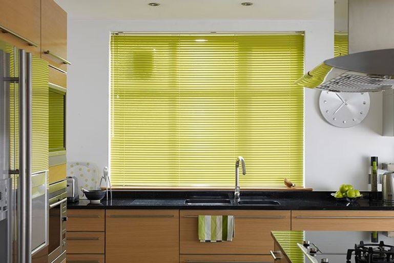 striking lime green venetian blinds hanging in a kitchen window
