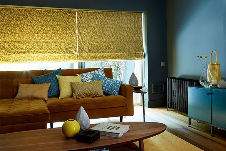 yellow patterned roman blinds in a contemporary styled living room window