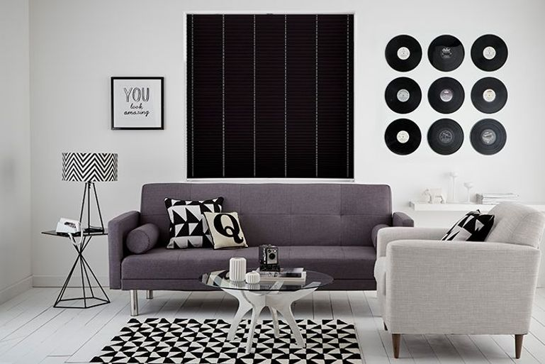 Black pleated blinds in a living room window