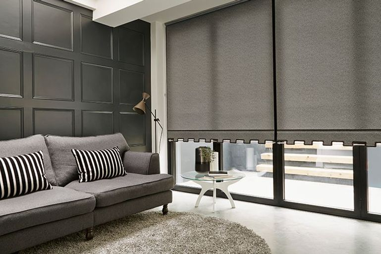 black roller blinds in a living room window