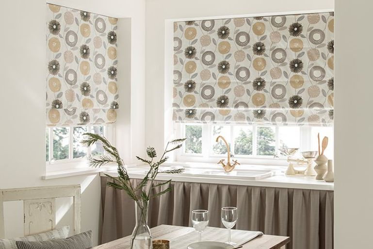 patterned roman blinds in a kitchen window