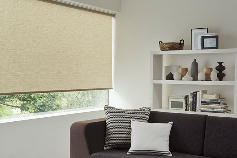light brown roller blinds in a modern living room window
