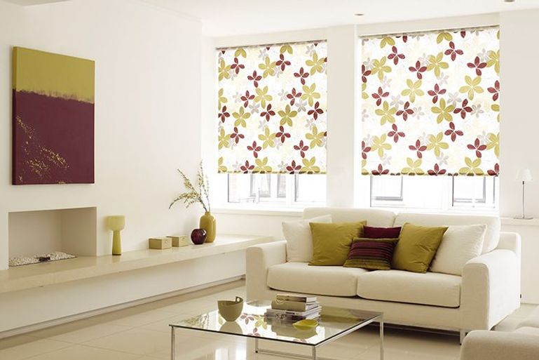 white roller blinds with large flower pattern in a living room window