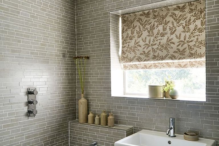 light brown roman blinds with wheat pattern in a bathroom window