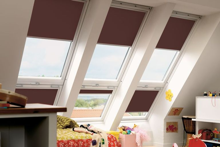 dark brown blackout velux blinds in a kids bedroom