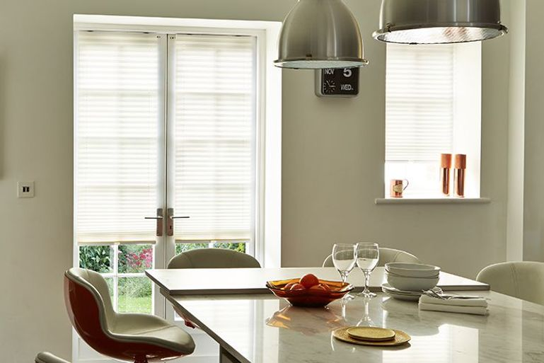kitchen dining room with cream pleated blinds at the window