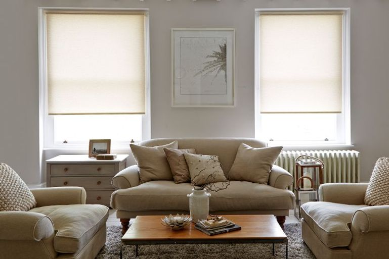 cream roller blinds in a modern living room