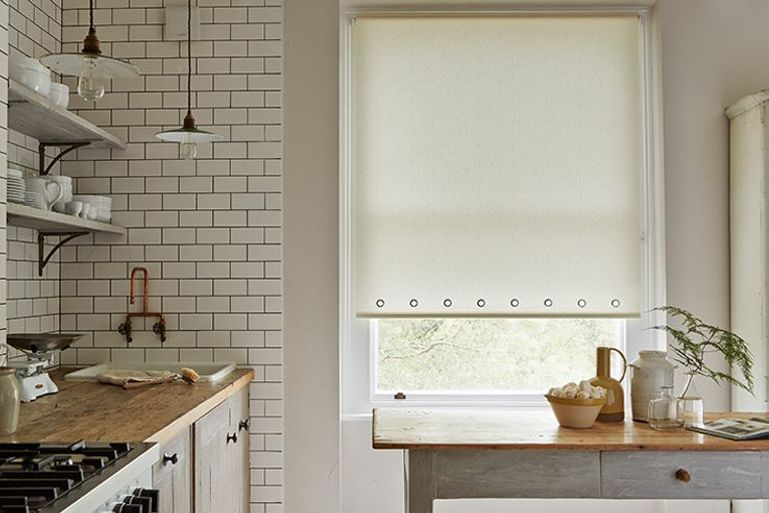 cream roller blinds in kitchen dining room