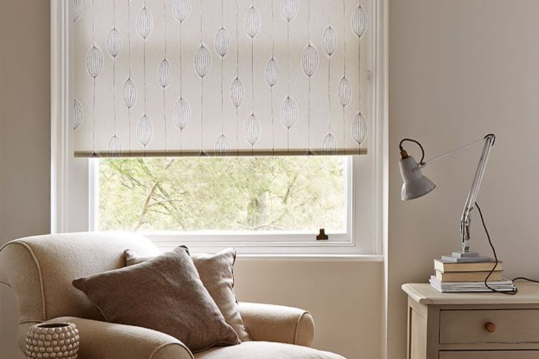 light cream roller blinds in a modern living room