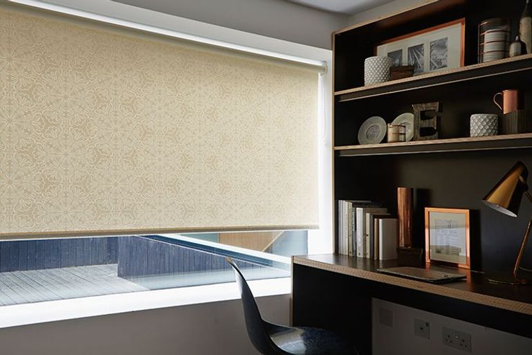 cream roller blinds in a modern home office
