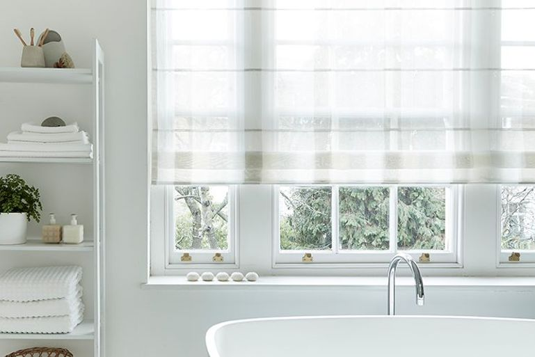 white ombre natural voile roman blinds in a bathroom
