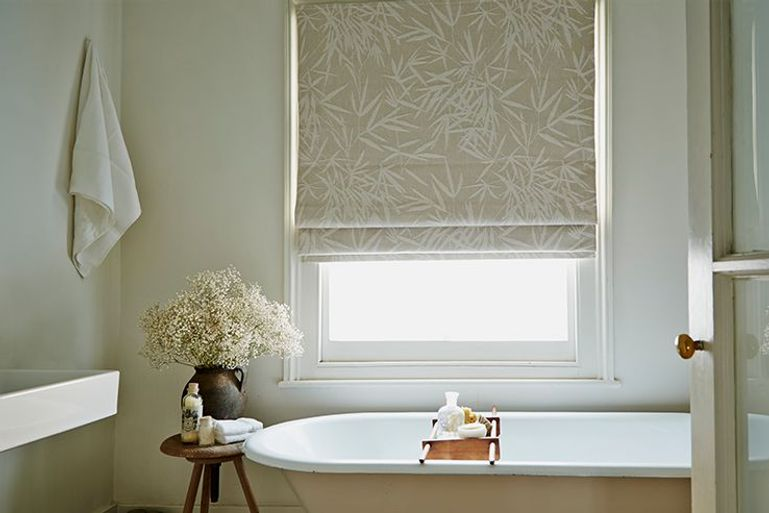 bamboo linen cream roman blinds in a bathroom window