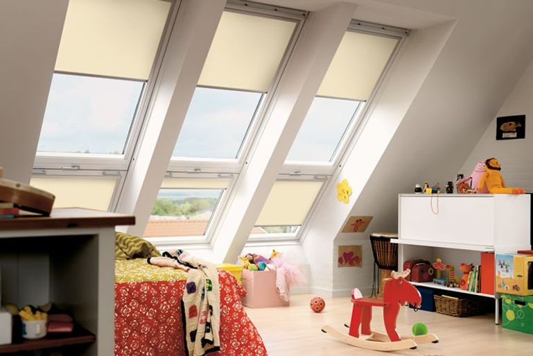 velux skylight blackout window blinds in a cream colour in a child's playroom