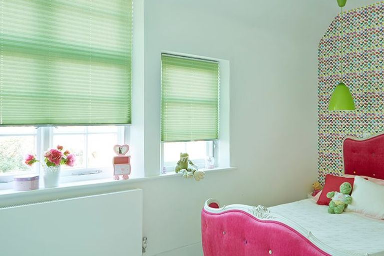 kids bedroom with green pleated blinds in the window