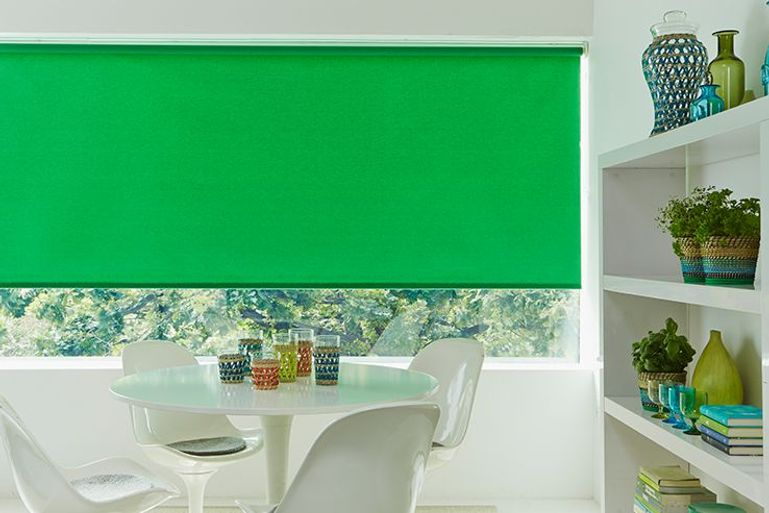 bright green roller blind in a modern dining room window