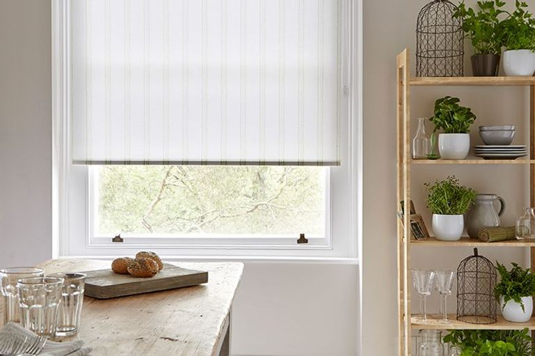 striped light green roller blinds in dining room window