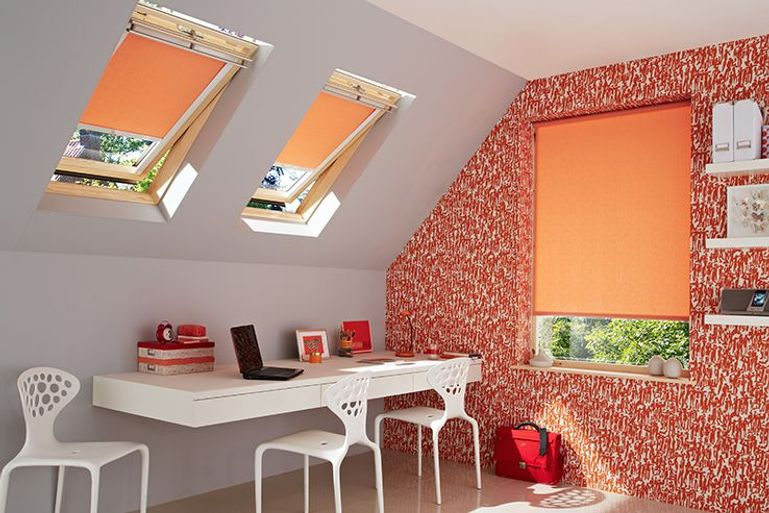 orange roller blinds in a brightly decorated home office window