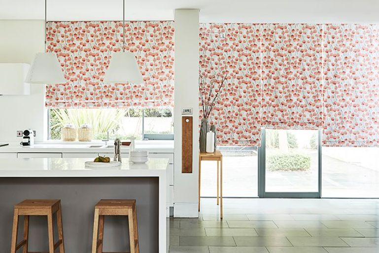 flowery patterned roman blind in an open plan kitchen window