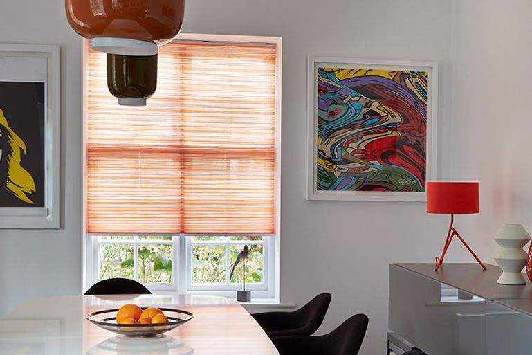 estelle pumpkin orange pleated blind in a modern kitchen dining room window