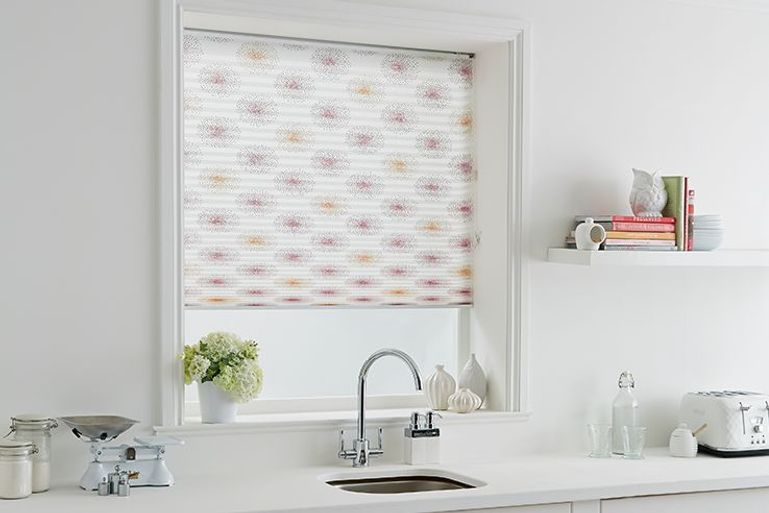 white with pink pattern pleated blinds in a kitchen window