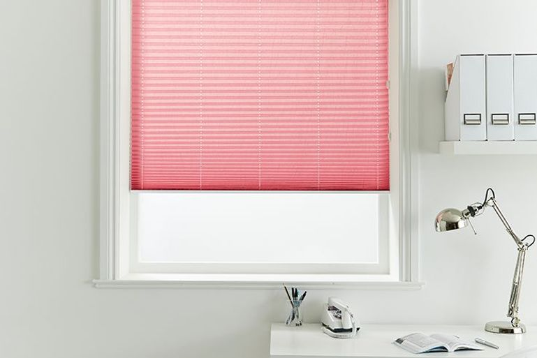 crush crimson pleated blinds in a home office window