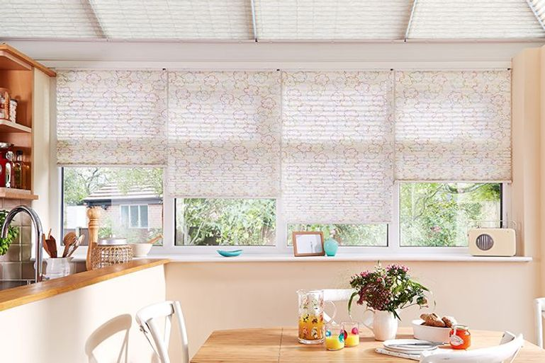 misha nature pink pleated blinds in a kitchen dining room window
