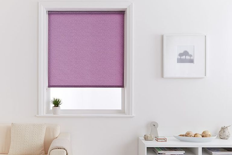 plain purple roller blind in a white living room